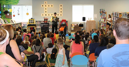 Magician Marty Westerman Dallas Texas after his magic show provides a library presentation for their Summer Reading Program