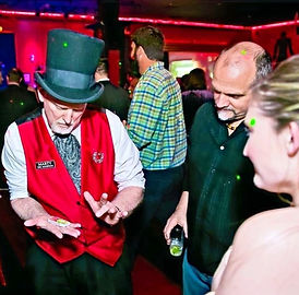 Magician Marty Westerman out of Dallas Texas performing close-up magic with audiance participation at a private event