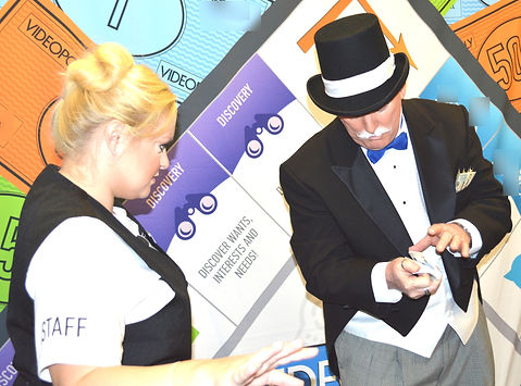 """Dallas Texas Magician Marty Westerman aka """"Rich Uncle Pennybag"""" Monopoly Man performing close-up comedy street magic for a marketing company to promote another company"""