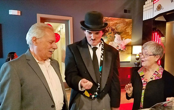 "Dallas Texas Magician Marty Westerman aka ""Charlie Chaplin"" impersonator performing close-up street magic at a senior living facility grand opening"