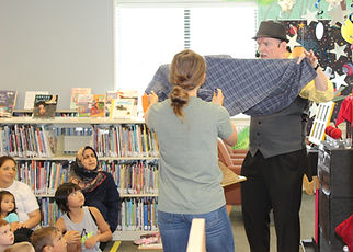 Magician Marty Westerman Dallas Texas performing a magic comedy show for a library Summer Reading Program for all to enjoy