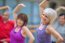 mature woman in exercise class