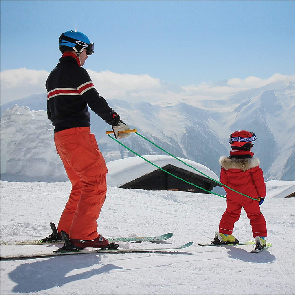 Child skiing with parent using Slope Ropes (tm)