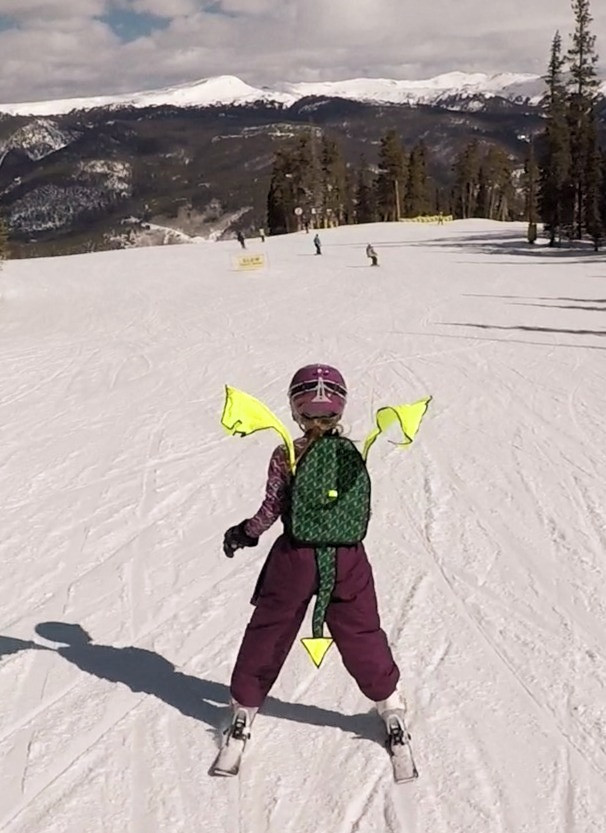 Child skiing with Dragon Pack for safety