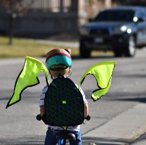 Kideaux Dragon Riding a Bike