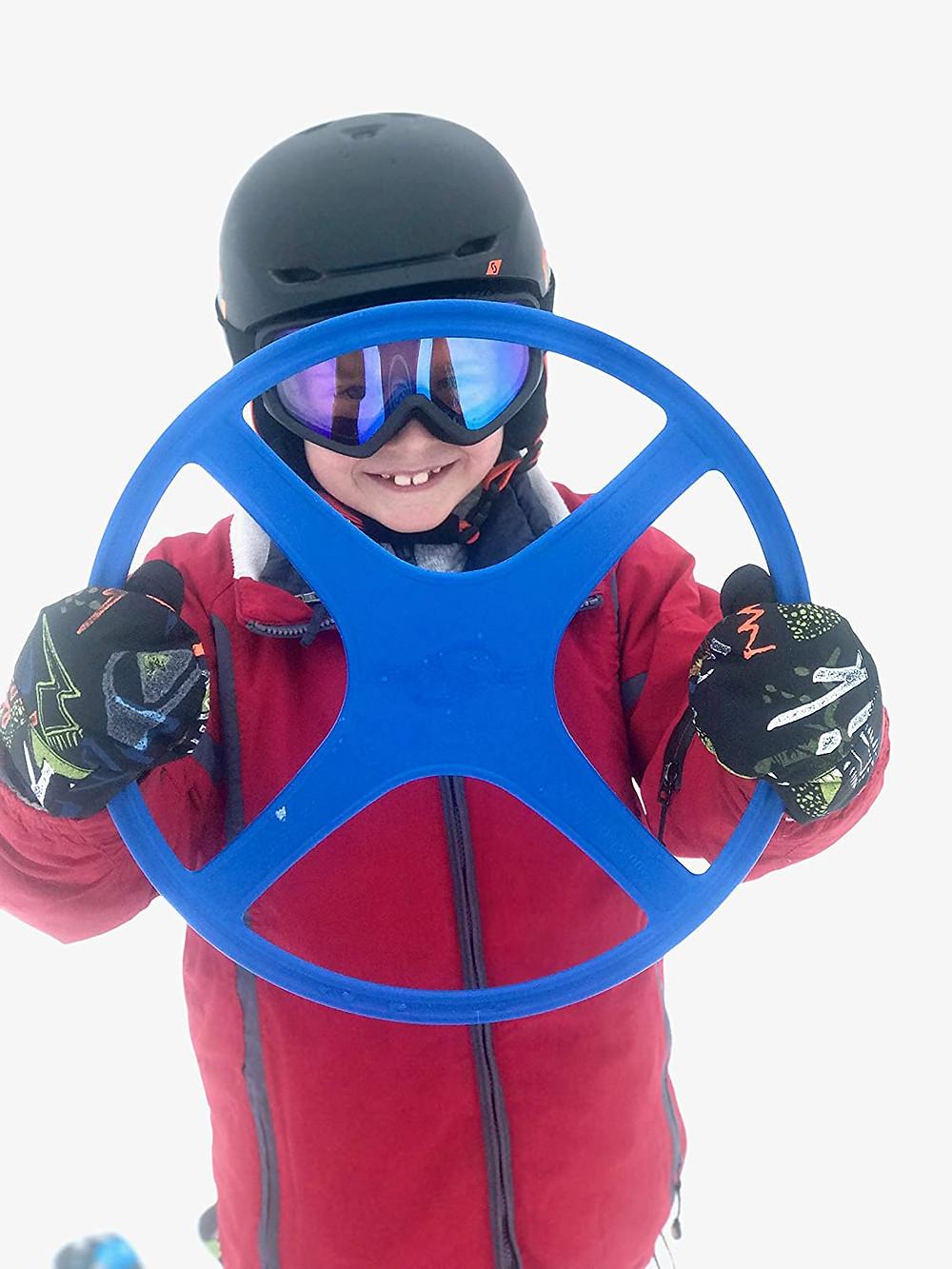 Ski child holding a Ski Ring