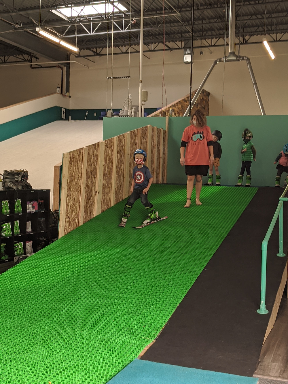 Toddler skiing at indoor ski school lessons