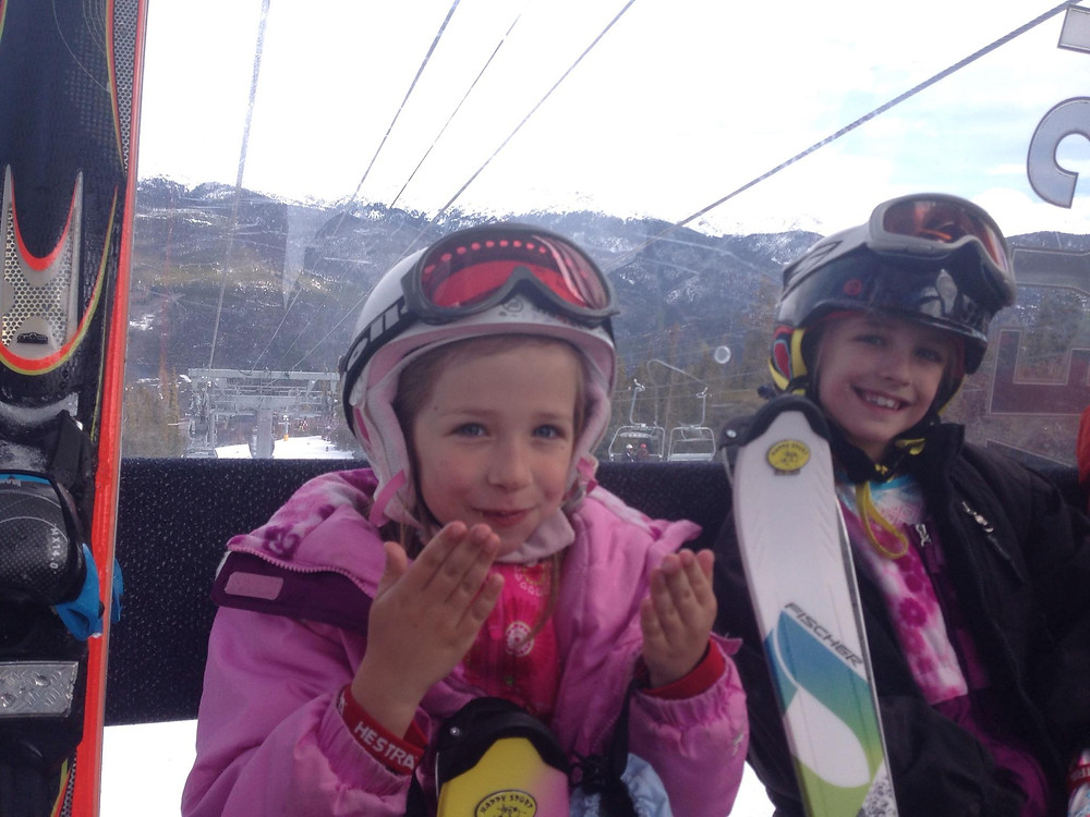 girl on ski lift getting warm