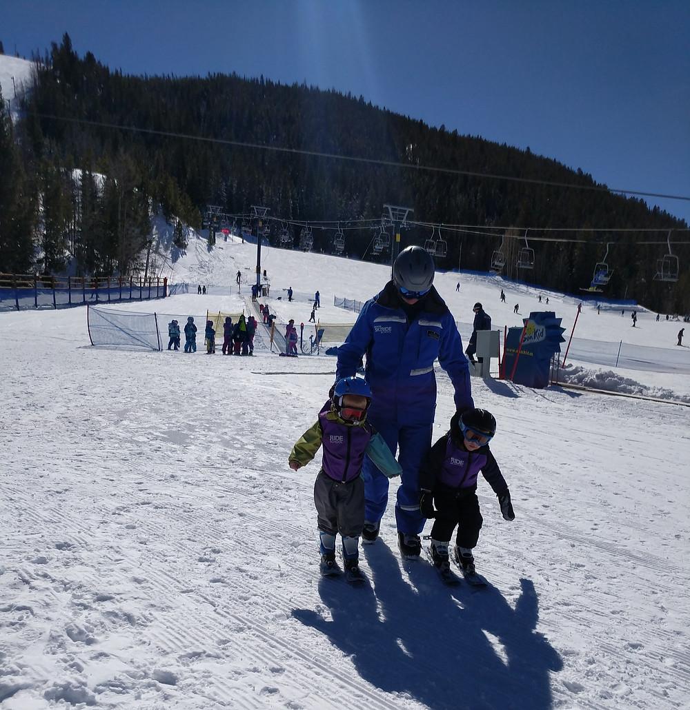 Toddler Skiing doing ski lessons