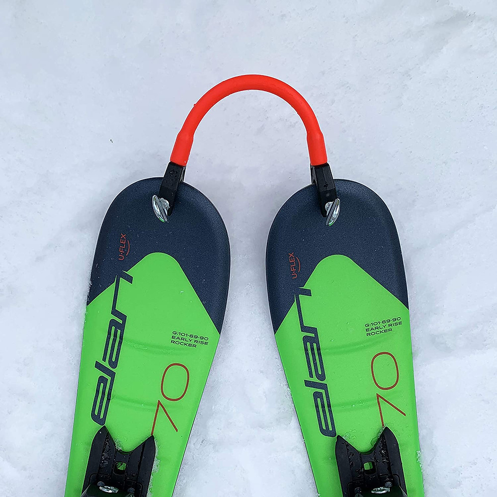 Edgie Wedgie attached to ski tips.