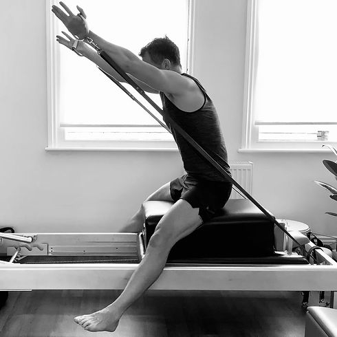 Horseback exercise on the Pilates reformer for a tall, lifted posture