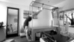 Full Hanging Pilates exercise on the Cadillac to reverse the effects of gravity and traction the legs and back