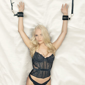 Liz Ashley in Alora Bed Restraints and cleaner and ethical bondage products