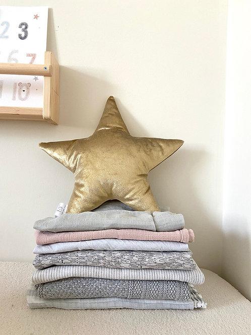 Gold velvet star cushion