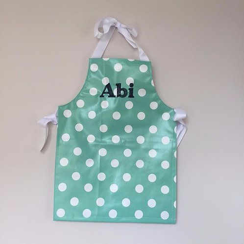 Personalised wipe-clean apron in polka-dot print- green/white