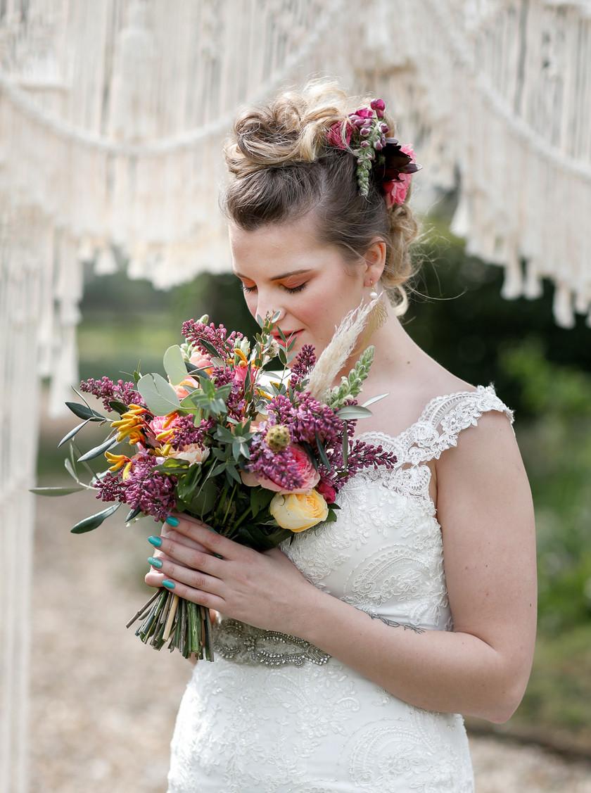 Country bridal wedding flowers, purple, yellow, orange and pink. Boho Aztec wedding idea