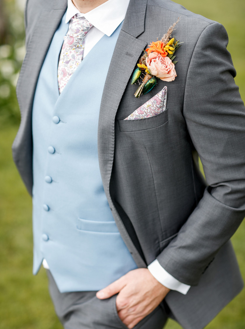 Grooms buttonhole. Boho inspired, orange, caramel with jewelled brooch
