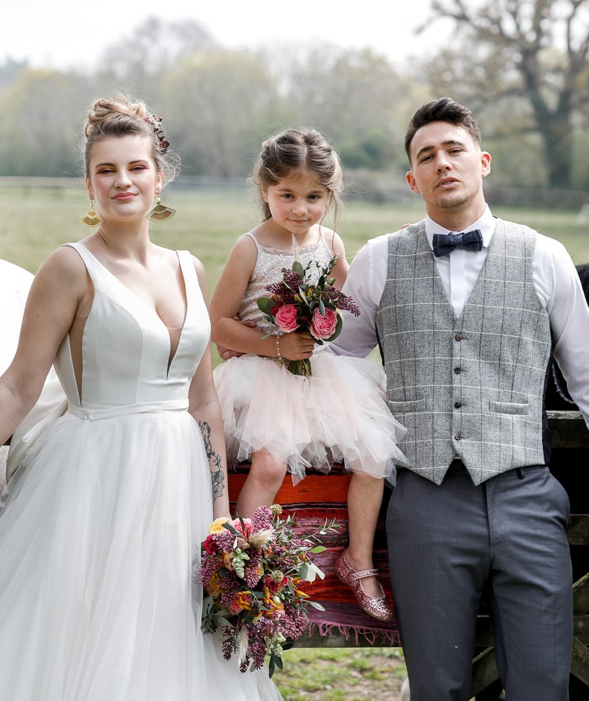 Outdoors wedding, vibrant boho wedding with a twist of country. Bride, groom and flower girl