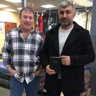 Russia Muslim with Bible.jpeg