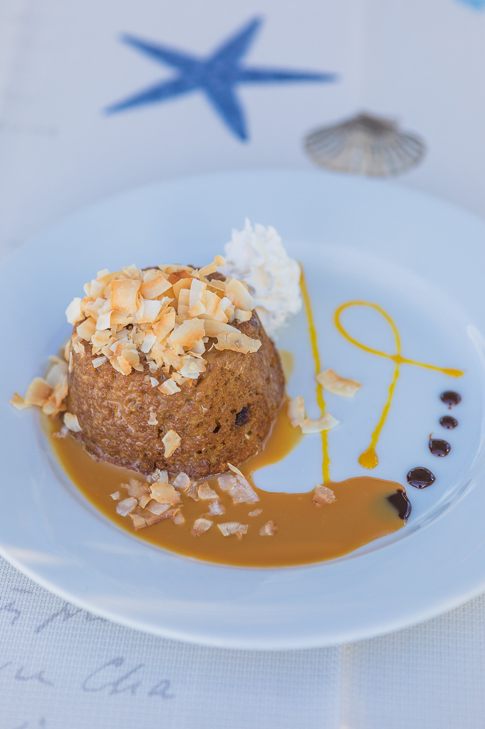 Best Desert from Harbour Grille Grand Cayman at Taste of Cayman 2019 Breadfruit cake with caramel sauce