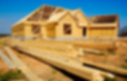 New home under construction with wood, t