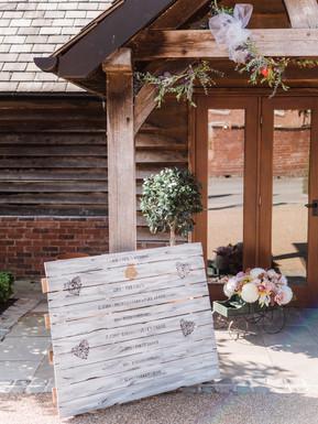 Sandhole Oak Barn welcome sign a the wedding venue