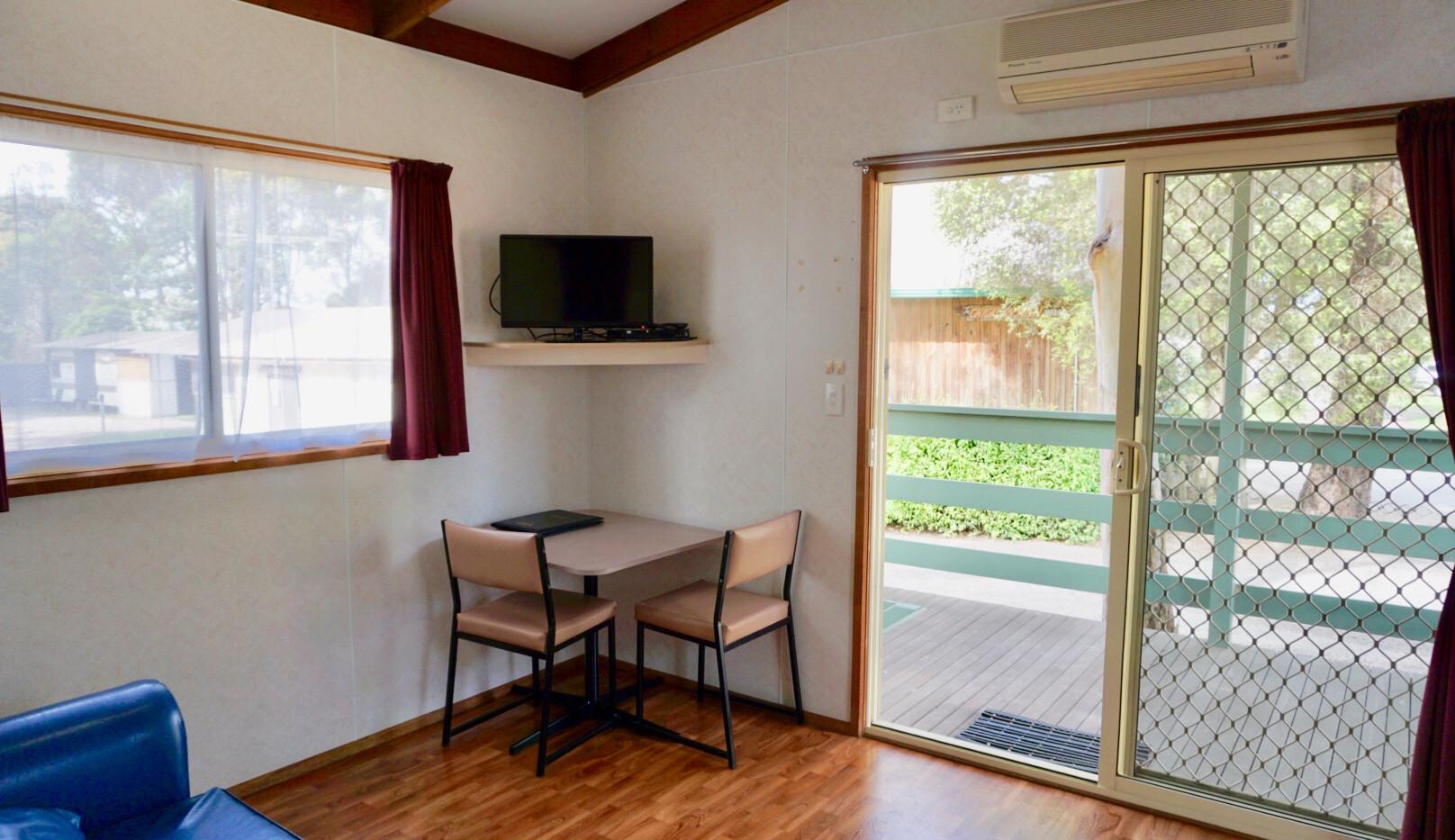 cosy cabin lounge and veranda