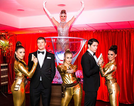 WinterWorks Entertainment - Bond Theme - Hosts - Hospitality - Dancers - Giant Champagne Glass - Events