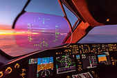 Why do commercial airplanes typically fly at 35,000 feet?