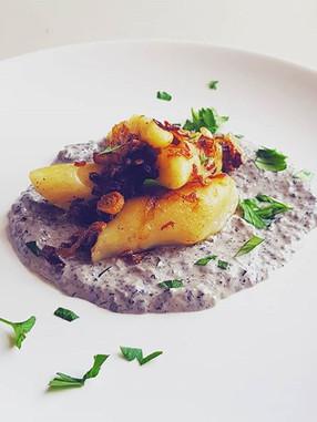 Polish KOPYTKA (potato dumplings) with f