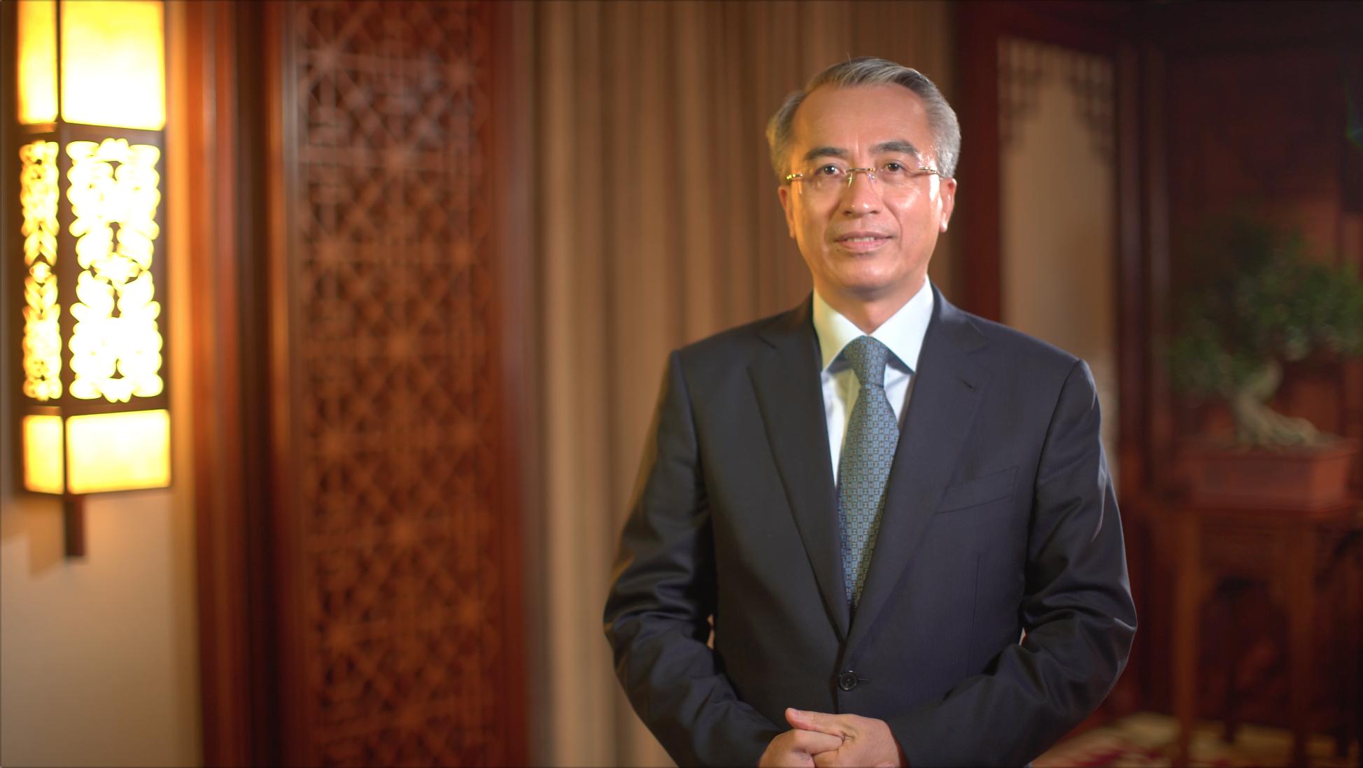 Mr. Cai was filmed standing.