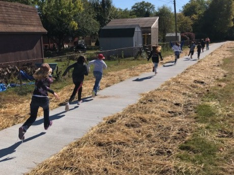 Smith Elementary students run on the new path that connects Eastgate neighborhood to the school property at the Southeast.