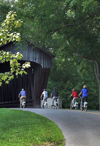 Photo of cyclists from Columbus Visitors Center https://columbus.in.us/see-do/mill-race-park/