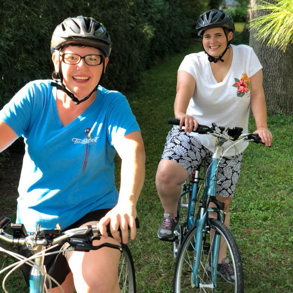 Samantha and Alexa Lemley pictured on their bicycles.