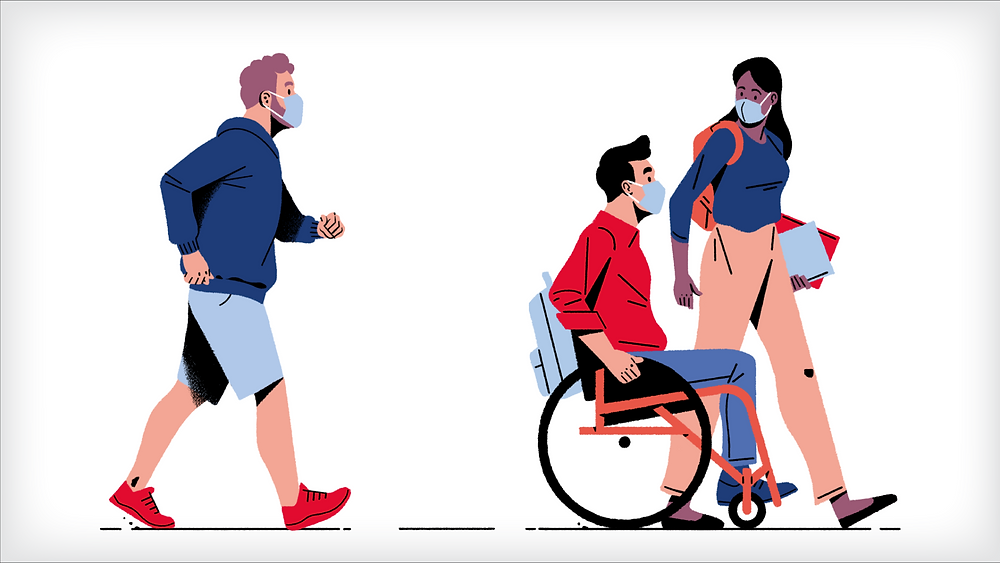 2 people walking and one person in a wheelchair, all wearing masks.