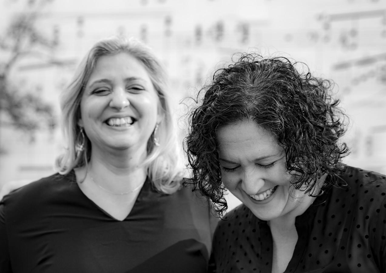 Basgoze-Pinto Piano Duo - B&W - Music Wall Candid 2