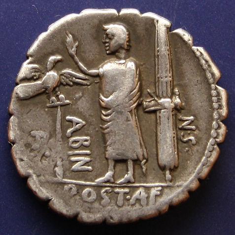 Denario postumia Hispania derrotada