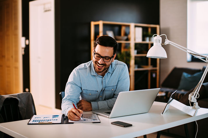 Young business man working at home with