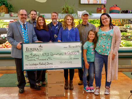 Eureka Natural Foods Presents Check for Wild Fire Relief