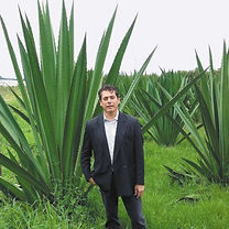 4. Alex with Fique plant wix.jpg