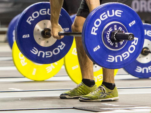 Take a close look at the heels. If the weight has shifted to the balls of the feet during the first pull, it's unlikely the lifter will be able to correct his or her balance later in the lift. (Thomas Campitelli/CrossFit Journal)