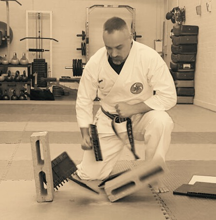 Demonstrating board breaking