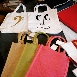 fabric totes with John Tees faces
