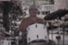Dad posing and smiling behind drums.jpg