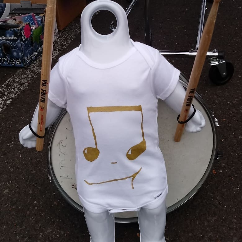 the baby headless drummer