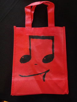 Red small tote bag with black 16th notes