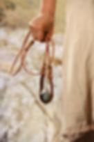 Hand of David holding slingshot with stone.jpg