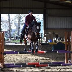 Sophia riding with Dom Schramm