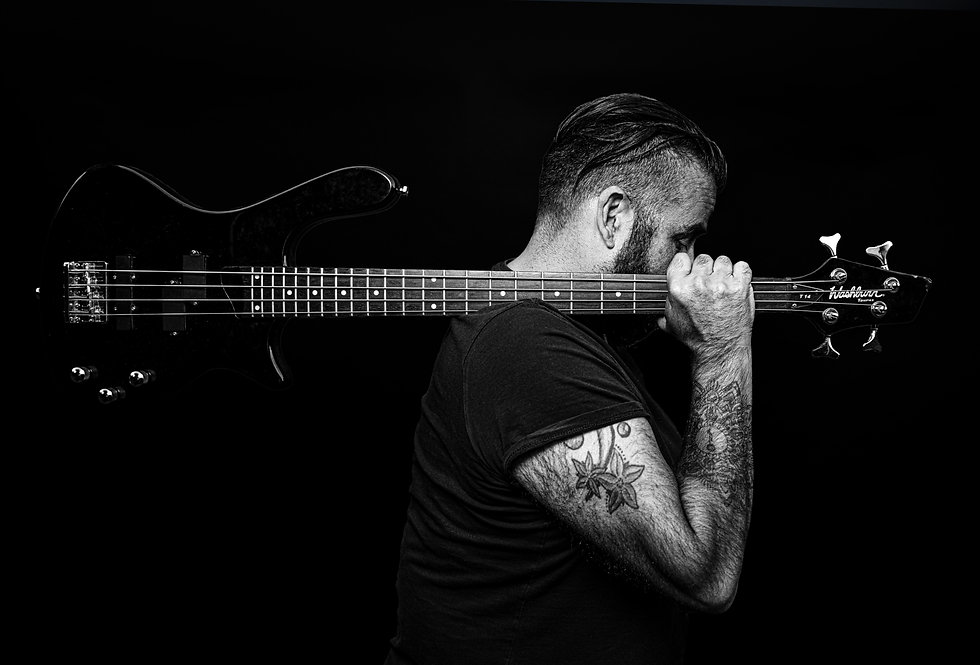 portrait of bass guitarist in black and white