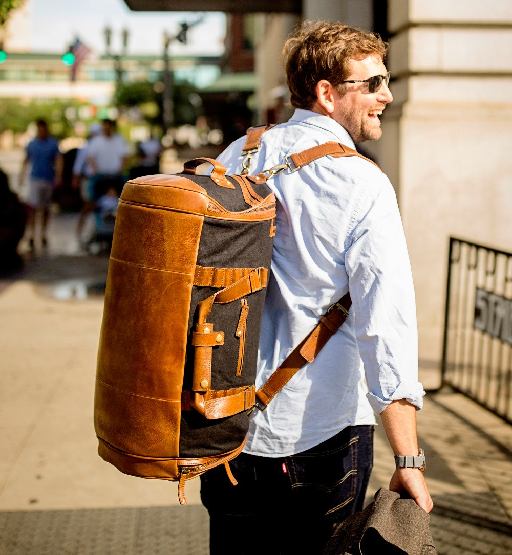 businessman with backpack duffel smiling